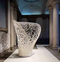 zaha hadid architects milan design week: made up of 7km of continuous structural strip, the form and pattern generated has been robotically 3D printed.