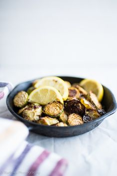 Spicy Oven roasted Brussels Sprouts - An amazingly simple recipe that needs only 5 ingredients + generous love to make anyone eat Brussels Sprouts. #sensationalsides #healthysides #easysides #recipes #roasted #potluckrecipes #partyideas #dinner #foodfor7stages #glutenfree #paleo #inagarten #thanksgiving #vegan
