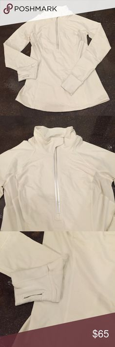 Lululemon Crisp White Pullover Yoga Workout Jacket I'm selling a gorgeous white Lululemon pullover jacket. Really nice reflective details down the front and down the entire length of the back. Size 8 with a zip up pocket on the back. Mint condition with no signs of wear lululemon athletica Jackets & Coats Utility Jackets