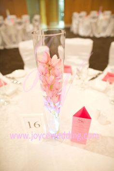 This #submerged #small #pink #orchid #centerpiece with #LED #light is #cute and #pretty. You may also add a few #candle #holders around to add more #sophistication at your choice.