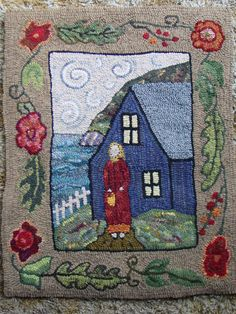 Woman on Path, hooked by me from a pattern by Deanne Fitzpatrick.