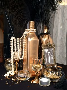 Learn how to make easy New Years Eve Party Decorations - Great Gatsby Theme. You can buy all the supplies you need at your local dollar store including gold spray paint, vases, pearl necklaces, gold glitter etc Great Gatsby Party Decorations, Great Gatsby Themed Party, Masquerade Party Decorations, Diy 20s Decorations, New Years Eve Party Ideas Decorations Diy, 1920s Party Themes, Black And Gold Party Decorations, 1920s Theme, Decoration Table