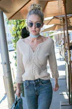 What's this? Oh just Gigi Hadid owning it again in jeans, a cosy knit and an amazing blue choker.