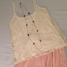 Gorgeous, Feminine Lace Overlay Top by Zara NWT Gorgeous, feminine light top with adjustable spaghetti straps.  Sheer lacy embroidered overlay and fully lined with 100% cotton inner tank.  The color is a very soft, light vanilla ivory.  Sz Small. New with Tags, never worn. Zara Tops Camisoles