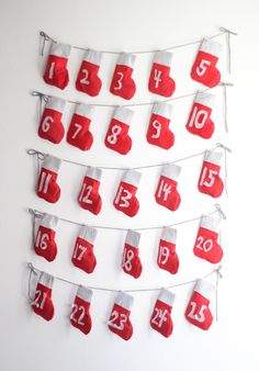 A fun and festive DIY Stocking Garland for the holidays - and it makes a perfect DIY Advent Calendar! Homemade Advent Calendars, Advent Calendar Gifts, Advent Calendar Activities, Advent Calendars For Kids, Diy Calendar, Diy Stockings, Christmas Stockings, Noel Christmas, All Things Christmas