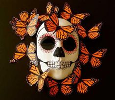 Dia de los Muertos - In Mexican culture it is believed that Monarch butterflies, migrating south this time of year, carry the returning souls of the departed with them. Day Of Dead, Day Of The Dead Mask, Day Of The Dead Party, Mascaras Halloween, Halloween Masks, Fall Halloween, Halloween Makeup, Mexican Skulls, Mexican Folk Art