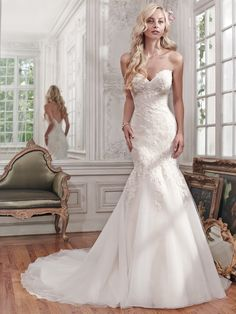 Maggie Sottero - MIRANDA, Gorgeous lace and tulle combine to create this stunning fit and flare wedding dress, accented with shimmering beads and a classic sweetheart neckline. Finished with covered buttons over zipper and inner elastic closure.
