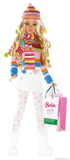 Winter style Barbie ... wearing a colorful striped matching hat, scarf, & sweater  + White mini skirt/boots + white/pink tights