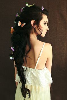 Long, cascading hair,/ butterflies woven into/ medieval dark plaits. ~ Fairytale hair haiku