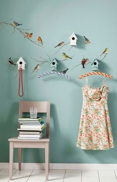 I love the bird houses and the painted birds...not so sure about the hanger idea but the 'look' certainly works!
