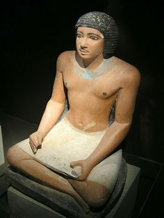 Seated statue of an Egyptian scribe found in the Western cemetery at en:Giza; 5th dynasty.