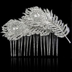 Wedding Hair Comb, Bridal Peacock Feather Hair Comb, Vintage Inspired Swarovski Crystal, Clear Rhinestone Tiara, Hair Accessories. $26.99, via Etsy.