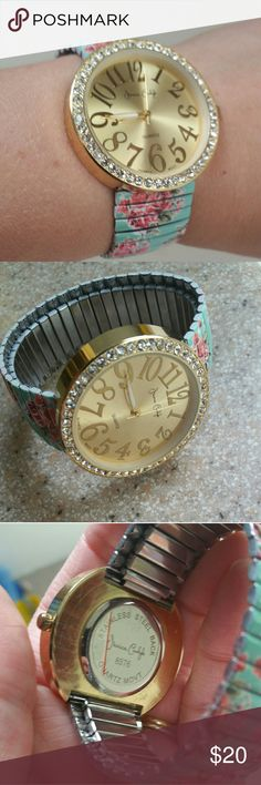 Jessica Carlyle floral stretch band watch Beautiful goldtone face surrounded by crystals.  Band is metalic stretch with teal floral pattern.  Excellent used condition.  Will need a new battery. Jessica Carlyle Accessories Watches