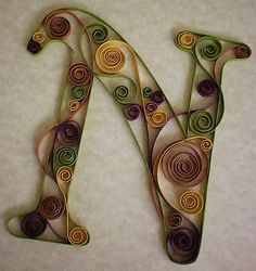 Quilling... http://www.iamjustlu.com/2010/10/weekend-crafts-felt-and-paper-creations.html