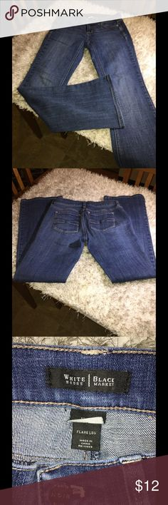 WHBM Flare Leg Jeans Size 0 White House Black Market jeans.  Flare leg style.  Size 0.  Medium blue rinse color. Inseam is 29.5 inches.  Good condition. Important:   All items are freshly laundered as applicable prior to shipping (new items and shoes excluded).  Not all my items are from pet/smoke free homes.  Price is reduced to reflect this!   Thank you for looking! White House Black Market Jeans Flare & Wide Leg