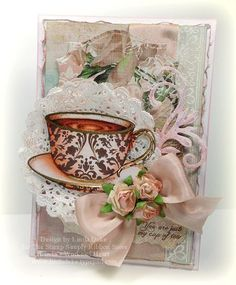 Beautifully Vintage using a tea cup by Kanban.  Created by Linda for The Stamp Simply Ribbon Store.
