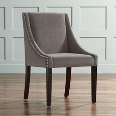 Decorative stitching on the back of the Lucille dining chair adds subtle style to this attractive look. Lucille dining chair with contoured arms. Style # at Lamps Plus. Wood Frame Construction, Living Room Accents, Nailhead Trim, Dining Room Chairs, Solid Wood, Velvet, Grey, Furniture, Stitching