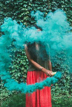 Hippie woman with green smoke bomb by Aleksandra Jankovic