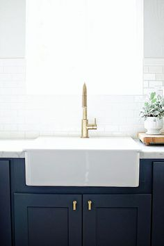 HGTV's Genevieve Gorder's favorite home decor and interior design picks for 2016 - on the Dog Lady Design Files blog! One of her favorites? Brass finishes. This brass faucet in the kitchen is stunning next to a farmouse sink and deep navy cabinets. A stunner! Interior Design, Home Decorating and Dog Musings from Jersey City www.dogladydesignfiles.com