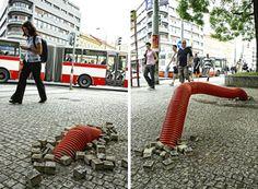 Groundbreaking Street Art Smashes Up Through Sidewalks