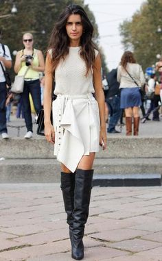 15 Italian It-Girls to know - Chiara Totire is an up-and-comer among Italian fashion icons. She has mastered the art of uber-hipster dressing. Pictured in an off white sleeveless sweater paired with a wrap skirt and black leather over the knee boots.