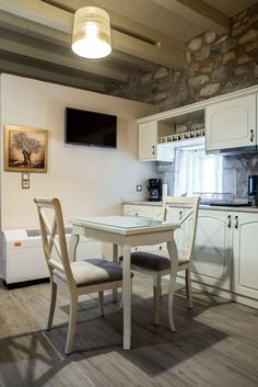 About a year ago, an old building of 1858 was transformed into a olea traditional guesthouse that combines all contemporary comforts. Old Building, Greeks, Dining Table, Traditional, Contemporary, Country, House, Furniture, Home Decor