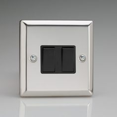 Mirror Chrome 2 gang Light Switch with Black inserts 1 or 2 way switching Rated at 10amp Suitable for switching either mains or low voltage lighting Bevelled Edge faceplate Dimensions 91x91x25mm BS EN 60669-1 – BRITISH MADE