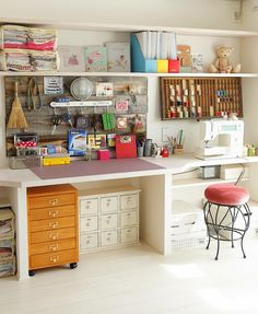 creative sewing room space with lots of craft storage- yes please....love the use of barn wood on wall