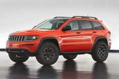 The 2014 Jeep Grand Cherokee Trailhawk Concept–the third Grand Cherokee created for Easter Jeep since 2011 - features 35-inch Mickey Thompson off-road tires on Wrangler Rubicon 17-inch aluminum wheels, enlarged wheel openings with custom fender flares, custom front and rear skid plates, dual rear tow hooks and modified Mopar rock rails.