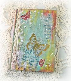 Janelle of Rain Puddles Design: Altering a book cover with Stampendous Impressions and Beacon Adhesives