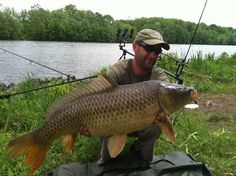 Polish-born and Chicago-based professional carp angler Marcin Szydlowski with a 22+ lb common carp caught during the 2012 Wild Carp Week Triathlon held in Baldwinsville, NY.