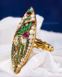"""Art Nouveau, Egyptian revival style yellow gold """"navette"""" shaped ring designed with Lotus Flowers all intertwined by Emerald French Cut stones designed as vines and set against various rose, round and circular cut diamonds. Bijoux Art Nouveau, Art Nouveau Jewelry, Antique Rings, Antique Jewelry, Vintage Jewelry, Emerald Diamond, Diamond Cuts, Jewelry Rings, Jewelery"""