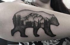 Landscape bear tattoo on forearm by Zeke Yip
