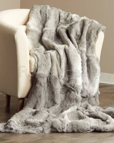 This is canadian sourced fur which has extremely humane practices by law and resembles the fox/coyote blankets u so often see in fabulous bedrooms but a fox is basically a dog so I'm more comfortable with rabbit plus it's less expensive Full Pelt Chinchilla Grey Rabbit Fur Blanket / Fur Throw