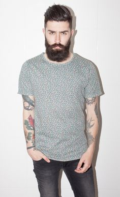 Manly man wearing bitty bitty flower printed shirt! The hair, the jeans the beard! what is not to love? Lookbook indeed!