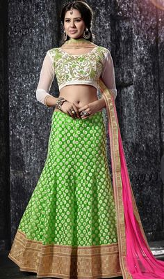Set the occasion ablaze draped in this lime green embroidered net cholie skirt. The ethnic lace, resham and stones work in the attire adds a sign of beauty statement for the look. Upon request we can make round front/back neck and short 6 inches sleeves regular cholie blouse also. #LightShadesOfLehengaCholi