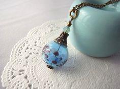 夏祭りのヨーヨーの様な水色の吹きガラスビーズのネックレス Creema