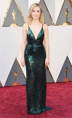 WHO: Saoirse Ronan  WHAT: Nominee, Actress in a Leading Role for Brooklyn WEAR: Calvin Klein Collection emerald sequin dress with velvet straps; Chopard jewelry.