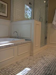 """corner tub + adjacent frameless glass shower. per the designer """"I always specify solid slab thresholds and jambs. One of the reasons I often use carrerra marble in bathrooms is because you can find ready-made marble jambs instock at any building centre in one of two materials, carrerra and jura beige."""""""