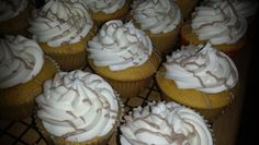 Yellow passion fruit cupcakes filled with guava and iced with butter cream and drizzled with min chocolate