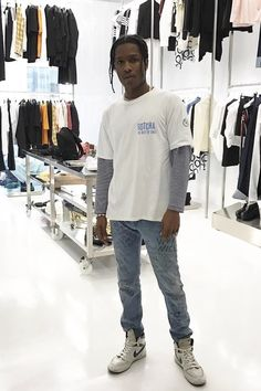 ASAP Rocky wearing Gucci Scribbled writing print punk pant, Guess 90s USA Embroidered Logo Striped