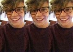 Ashton Irwin with glasses