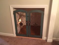 Dog room under stairs. Doors from hobby lobby.