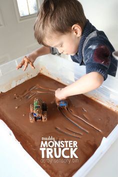This muddy monster truck derby sensory bin is just bursting with messy fun! The mud smells delicious and is taste-safe, but doesn't taste delicious, which discourages eating. Toddler Sensory Bins, Baby Sensory Play, Sensory Tubs, Sensory Boxes, Toddler Fun, Toddler Preschool, Learning Activities, Preschool Activities, Sensory Play For Toddlers