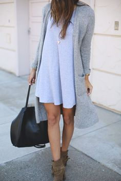 Muted tones don't have to be boring. A long cardigan is an practical transitional piece. Wear it with your