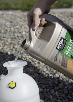 Adding deck cleaning solution to a sprayer