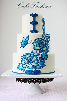blue floral painted cake sans fondant on top tier and butterfly