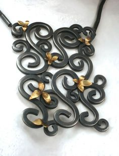 "Wrought Panel Pendant by Natasha Wozniak | This piece measures 2""x 3"" and the chain is 16"" $ 1,620.00"