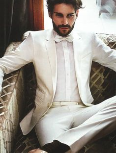 Look stunningly handsome in this light colored tan almost off white suit all the groomsmen would wear this