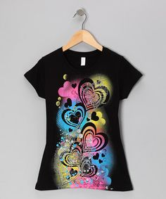 The graphic tee is great for a comfy cool top to grab during early morning rushes. We love this one even more for its colors and sprinkling of glitter!